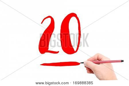 The number 20 written by a hand on a white background