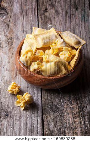 Pasta Ravioli In Wooden Bowl