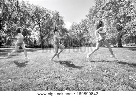 Multiple image of young fit woman jogging at park