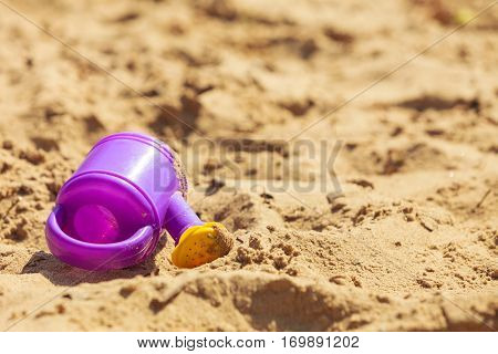 Summer fun time. Holidays and vacation. Childrens' toys lying on sand beach.