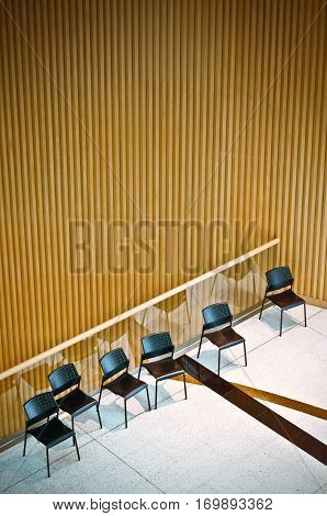 Many Chair In A Hall And Wood Background