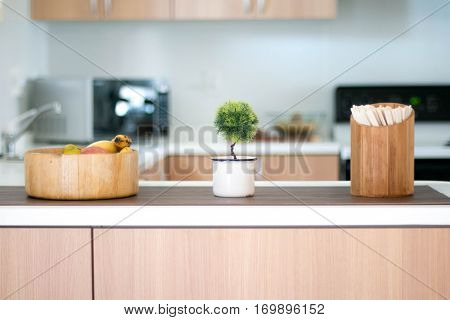 Faux topiary on a bamboo kitchen counter
