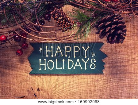 happy Holiday written on wooden background