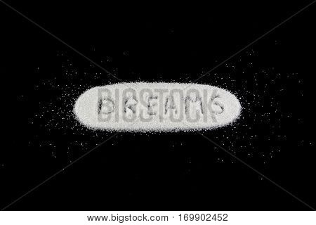 White Sugar With The Word Dreams. Sweet Dreams Concept.