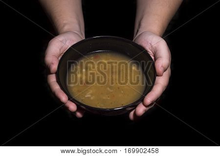 Holding A Bowl Of Soup. Poverty Concept