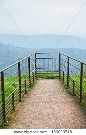 Viewing platform on top of mountains in France with impressive view over green forest