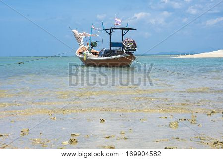 fishing boat in beach blue sky in aisia