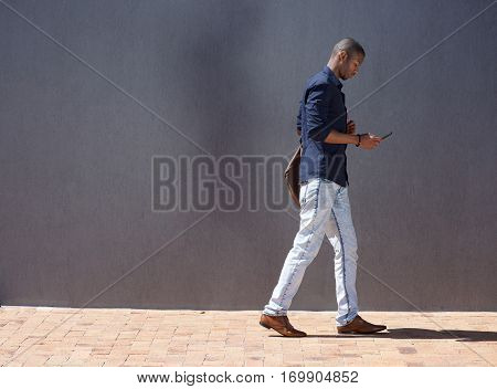 African Male Student Walking With Tablet