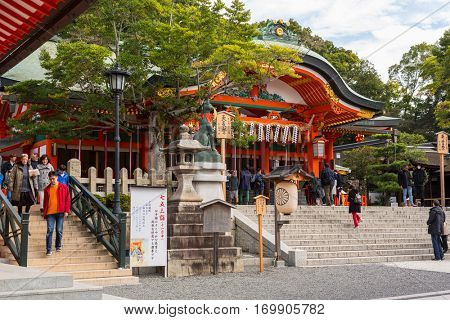 KYOTO, JAPAN - NOVEMBER 10, 2016 : Buddhist temple at Fushimi Inari Shrine with thousands of torii gates in Kyoto, Japan. Torii is a traditional Japanese gate commonly found in a shrine.