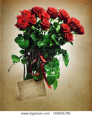 bunch of red roses with greeting card