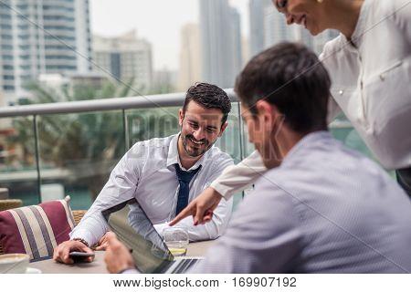 Collegues having an outdoor casual meeting in Dubai.