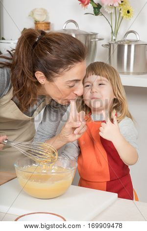 Funny Mother And Child Tasting Whipped Cream With Finger