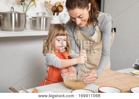 Woman And Child Cooking Whipping In Bowl