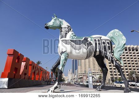 DUBAI UAE - DEC 6 2016: Colorful horse statue at the Dubai Creek in Deira. Dubai United Arab Emirates Middle Eas