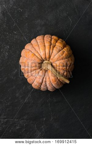 Overhead Shot Of Cinderella Squash On Dark Gray Stone Surface