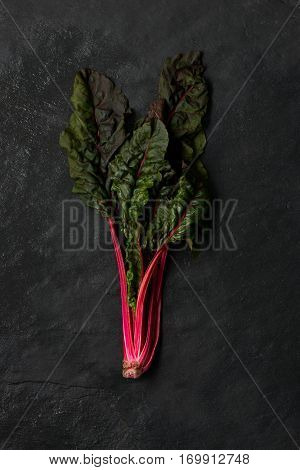 Red Chard On A Dark Grey Stone Surface