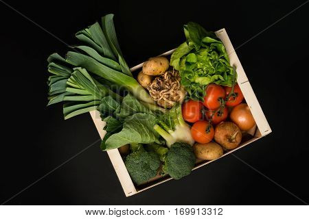Assortment Of Fresh Vegetables In A Wooden Crate