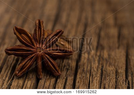 Star anise on old wooden table. Selective focus.