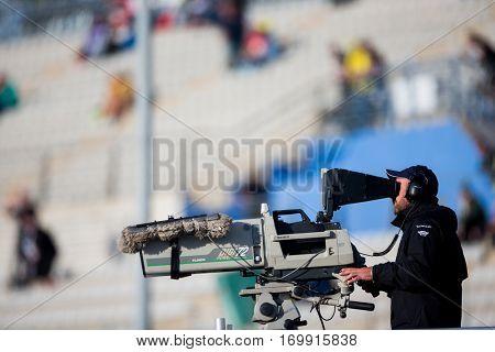 VALENCIA, SPAIN - NOV 12: TV camera operator during Motogp Grand Prix of the Comunidad Valencia on November 12, 2016 in Valencia, Spain.