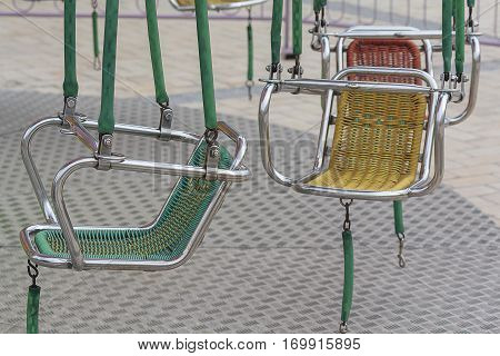 Metal swing seat on the town square close-up. Childhood