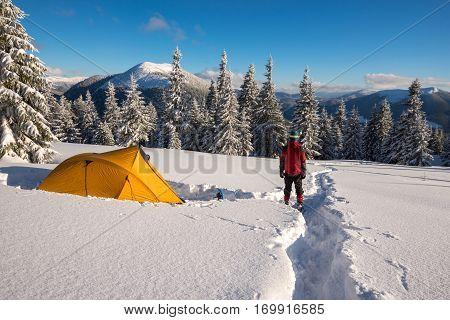 Man, Traveler In Snowshoes Is Enjoying Stunning Views