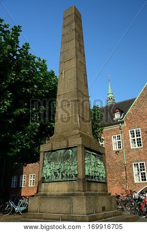 A view of a stone obelisk memorial in Copenhagen