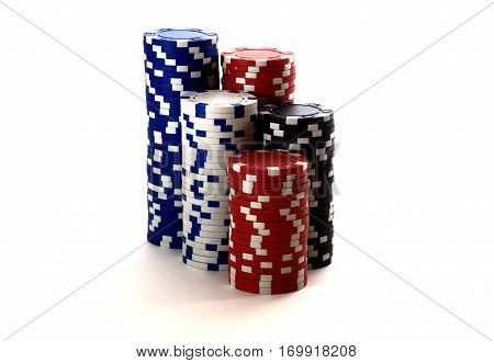Casino chips close up. Casino chips isolated on white background. Color chips over white backdrop.