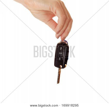 Car key in hand isolated on white background. Black ignition key close up. Car sales background.