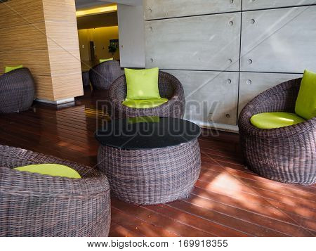The Patio Furniture set with green pillow