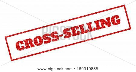 Red rubber seal stamp with Cross-Selling text. Vector message inside rectangular banner. Grunge design and scratched texture for watermark labels. Inclined emblem.