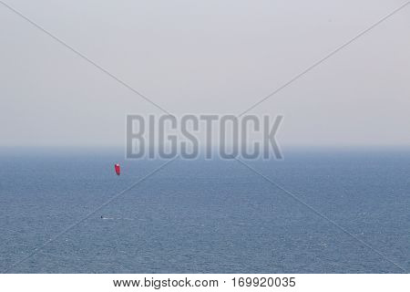 minimalism human scale of lonely kite surfing at gulf of Hua Hin Thailand with copy space