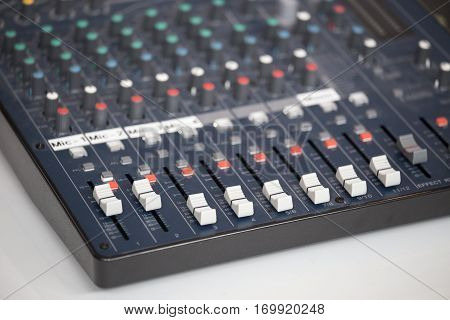 close up vintage audio mixing console board