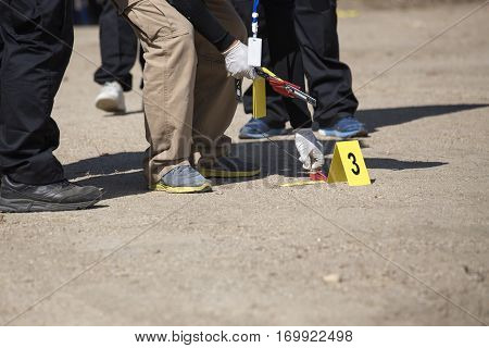 forensic or law enforcement team searh and evidence marker in crime scene training