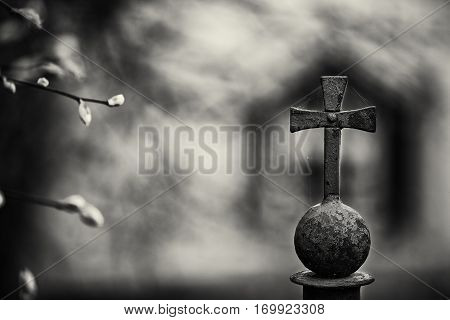 Black and white art photo mood park railing with a cross bokeh. outdoors
