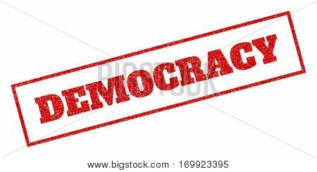 Red rubber seal stamp with Democracy text. Vector caption inside rectangular shape. Grunge design and dust texture for watermark labels. Inclined sticker.