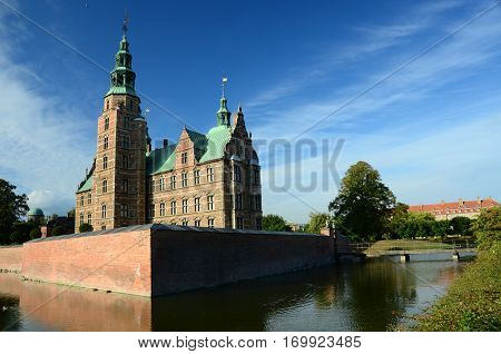 An external view of a castle and its moat in Copenhagen