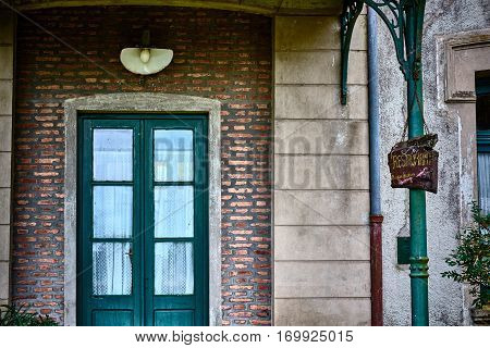 The Door And The Sign In The Back