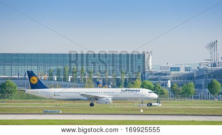 Munich Germany - May 6 2016: Jet airliner Airbus A321-231 of Deutsche Lufthansa AG airlines after landing taxiing on pushback tug at Munich international passenger airport