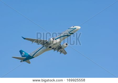 Munich Germany - May 6 2016: Jet plane Embraer E-Jet ERJ-195 of Air Dolomiti Italian airlines take off from Munich international passenger airport and gains altitude.