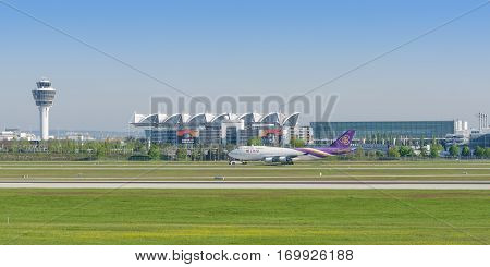 Munich Germany - May 6 2016: Passenger turbojet airliner Boeing 747-400 of Thai Airways International airlines taxiing on pushback tug in Munich international airport