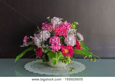 Beautiful aster flower bouquet on wooden table background.