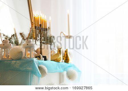 Beautiful fireplace decorated for Hanukkah, closeup