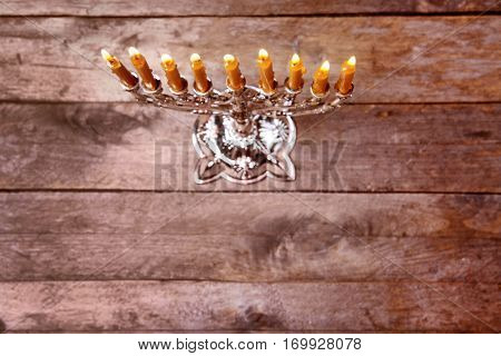 Menorah with candles for Hanukkah on  wooden background