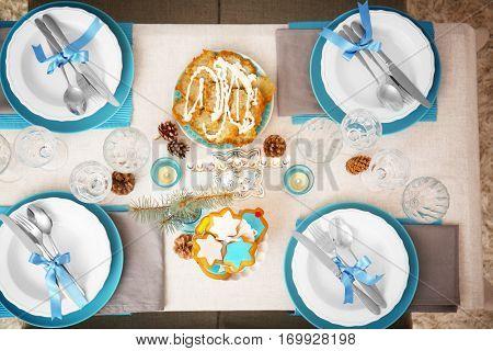 Beautiful table setting with menorah for Hanukkah