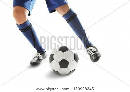 Legs of young man playing football on white background