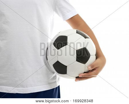 Young soccer player with ball on white background, closeup