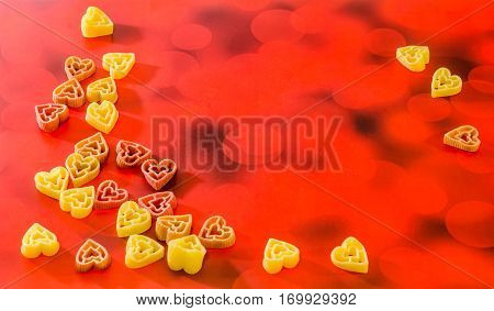 Red, Yellow And Orange Heart Shape Pasta, Close Up, Degraded Background.