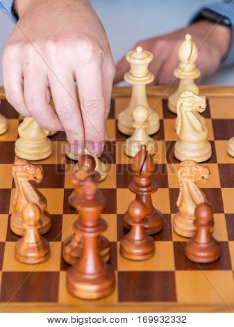 Middle Game - The Hand With Pawn Makes A Move On Chess Board