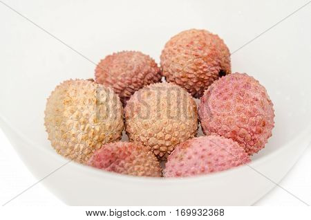 The Lychee (litchi Chinensis) Fruits, Close Up, Macro, Isolated. Genus  In A White Bowl