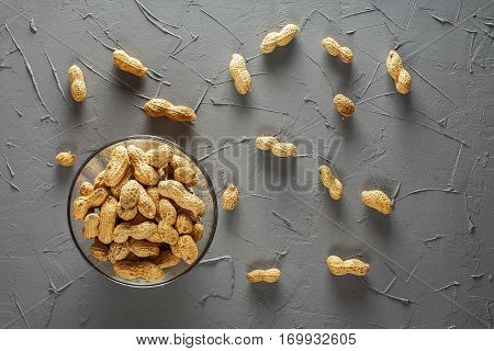 A pile of peanuts in a glass bowl